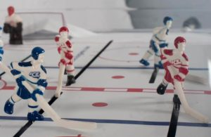 "close up photo of SuperChexx ""bubble hockey"" figures (players)"